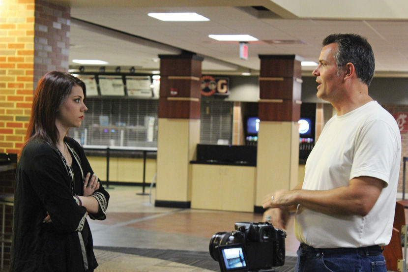 Director Bret Jones discusses the next scene with actress Rian Leigh in September in the Rhatigan Student Center. The film Redux will get four screenings Feb. 1 - 4.