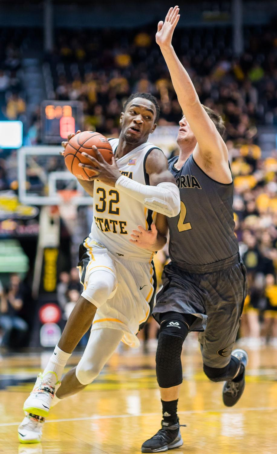 Freshman Markis McDuffie drives into the paint against his Emporia State opponent Nov. 21. McDuffie scored 15 points against the University of Northern Iowa on Wednesday and rallied a second-half victory of the Panthers.