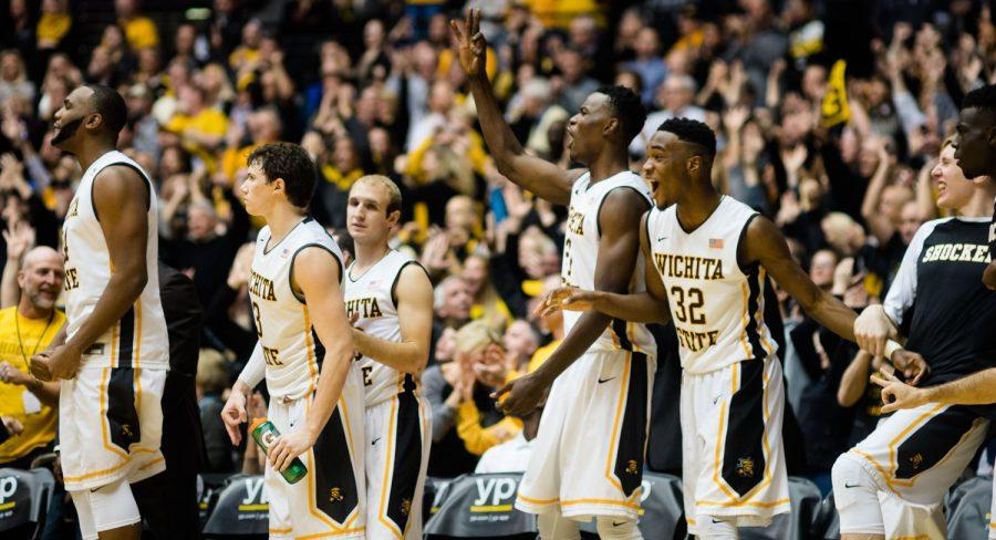 The+Shocker+bench+celebrates+a+three-point+basket+Wednesday+at+Charles+Koch+Arena+against+Evansville.+Wichita+State+outlasted+the+Purple+Aces+67-64+to+remain+undefeated+in+Missouri+Valley+Conference+play.