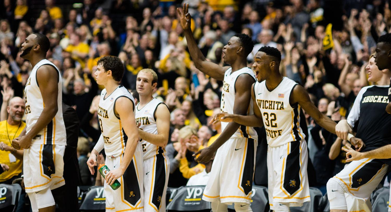 The Shocker bench celebrates a three-point basket Wednesday at Charles Koch Arena against Evansville. Wichita State outlasted the Purple Aces 67-64 to remain undefeated in Missouri Valley Conference play.
