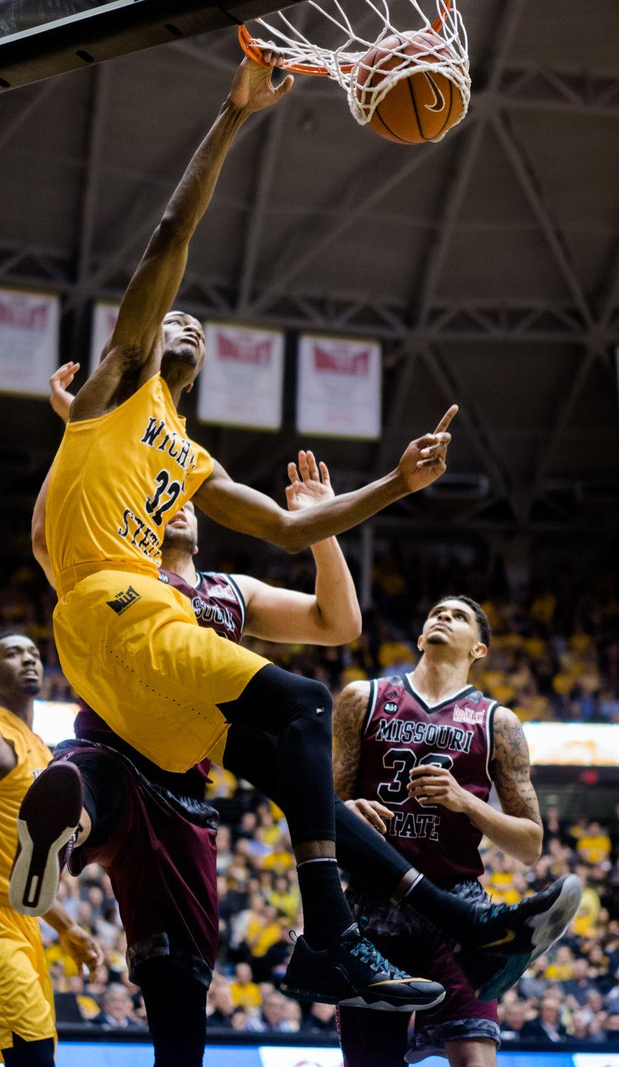 Freshman Markis McDuffie stuffs the ball Thursday night against Missouri State at Charles Koch Arena. It was one of 10 slam dunks for the Shockers as they went on to defeat the Bears 99-68.
