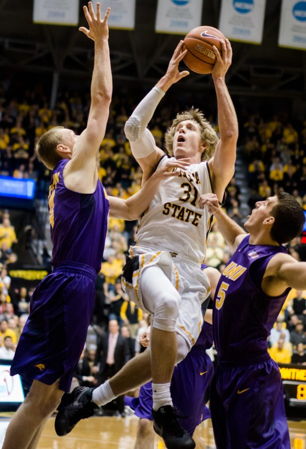 Ron+Baker+goes+up+for+a+shot+against+the+University+of+Northern+Iowa+on+Saturday.+Baker+finished+with+12+points+and+was+the+leading+scorer.+The+Panthers+defeated+the+Shockers+53-50+to+break+WSU%27s+home-winning+streak.