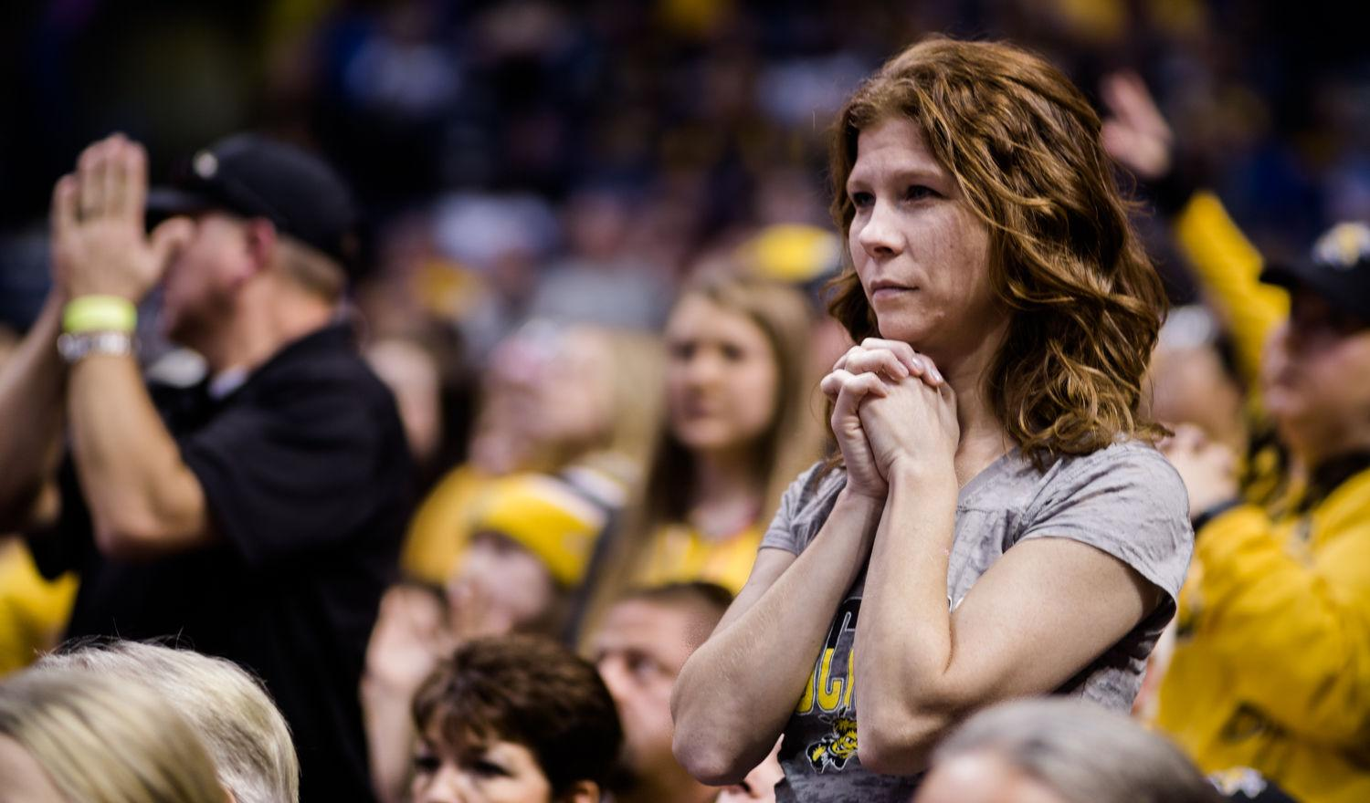 A Wichita State fan anxiously awaits the outcome of the semifinal game versus Northern Iowa in St. Louis on Saturday.