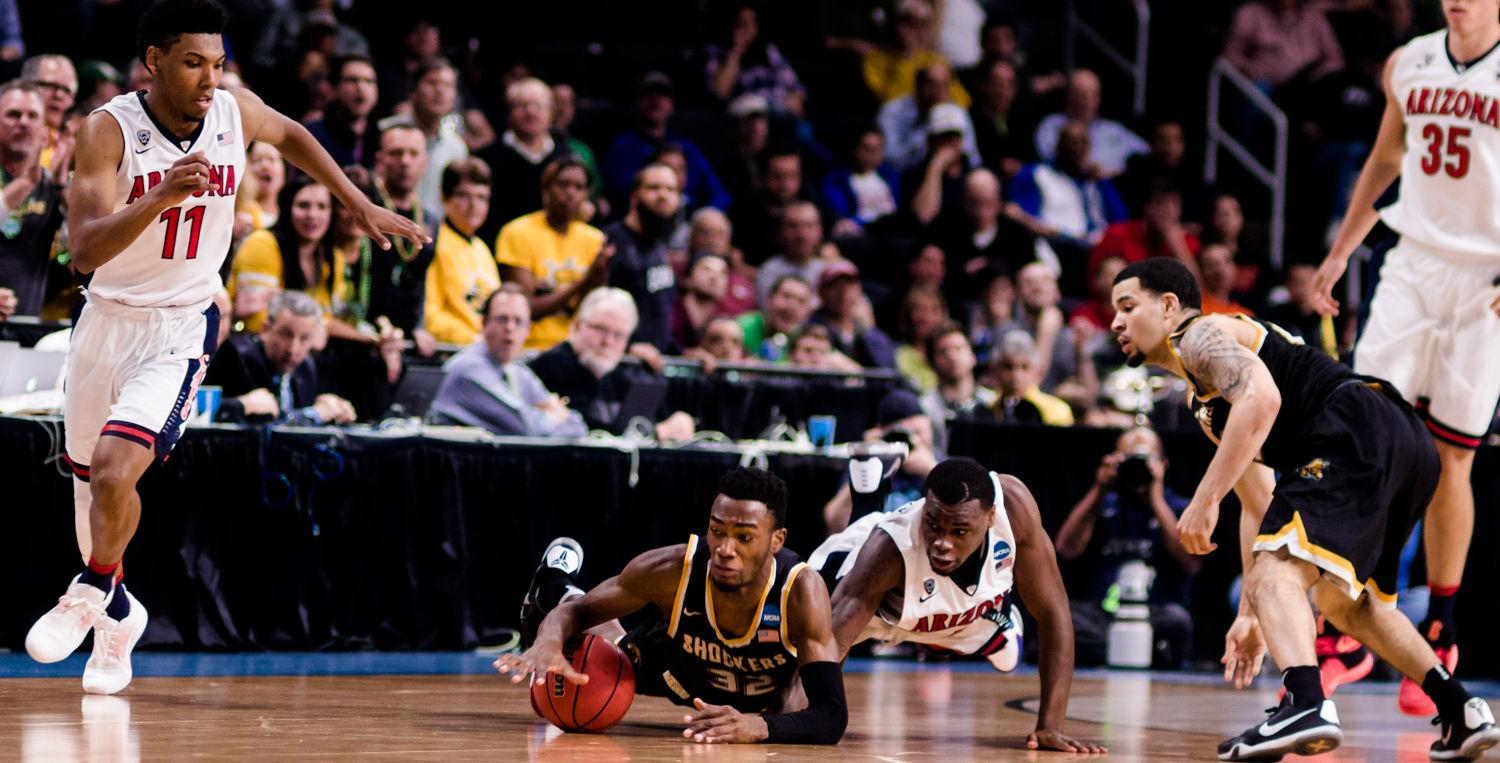 Freshman Markis McDuffie dives for a loose-ball against Arizona. WSU forced Arizona to 19 team turnovers, in route to a 65-55 victory in the first round of the NCAA Tournament.