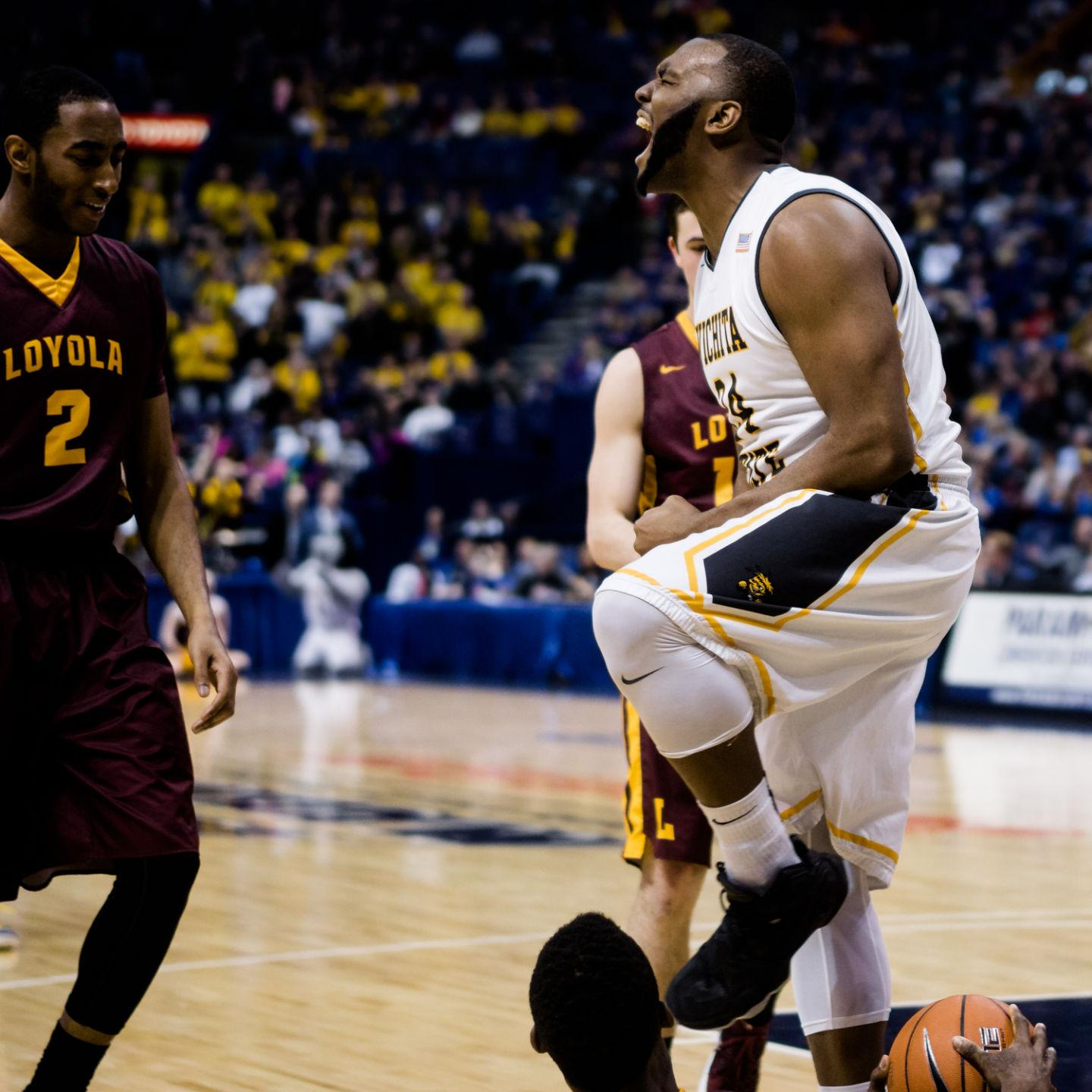 Sophomore forward Shaq Morris celebrates a block against Loyola in the quarterfinals of Arch Madness. Morris finished with six blocks as the Shockers defeated the Ramblers.