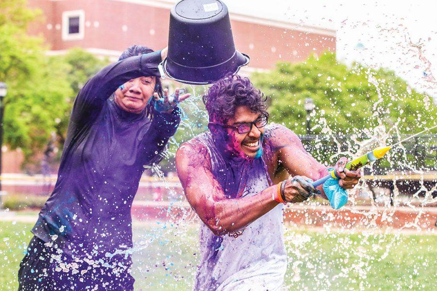 Students play with color and water during the 2015 HOLI Festival of Colors.