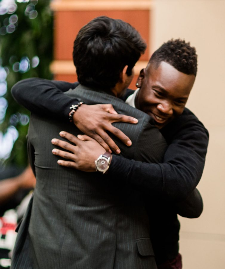 Joseph Shepard embraces his running-mate, Taben Azad, after their ticket was announced as the winning candidates for 2017-17 student body president and vice president.