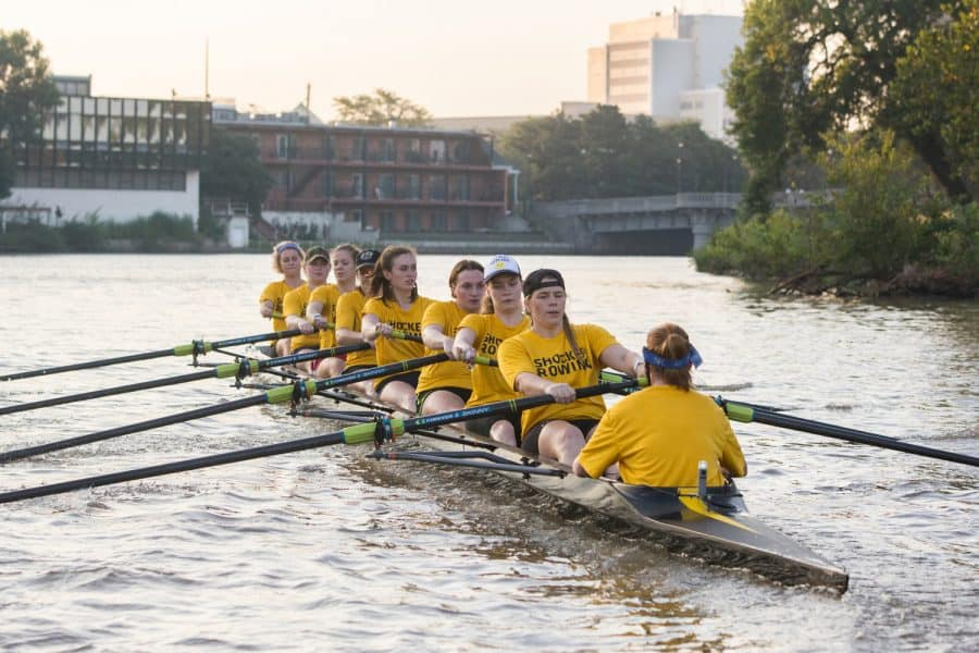 The women's varisty rowing team practices on the Little Arkansas River on Wednesday morning. Coach Calvin Cupp motivated his team saying,