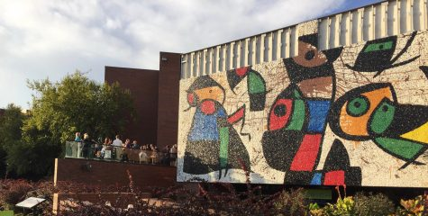 """Attendants to Tuesday's Joan Miró mosaic reception enjoy the view of the restored Personnage Oiseaux, or """"Bird People,"""" mosaic. The mosaic's restoration was a nine year process."""