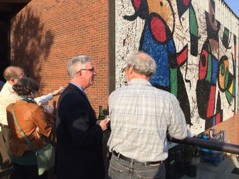 """Attendants to Tuesday's Joan Miró mosaic reception enjoy a drink and the view of the restored Personnage Oiseaux, or """"Bird People,"""" mosaic. The mosaic's restoration was a nine year process."""