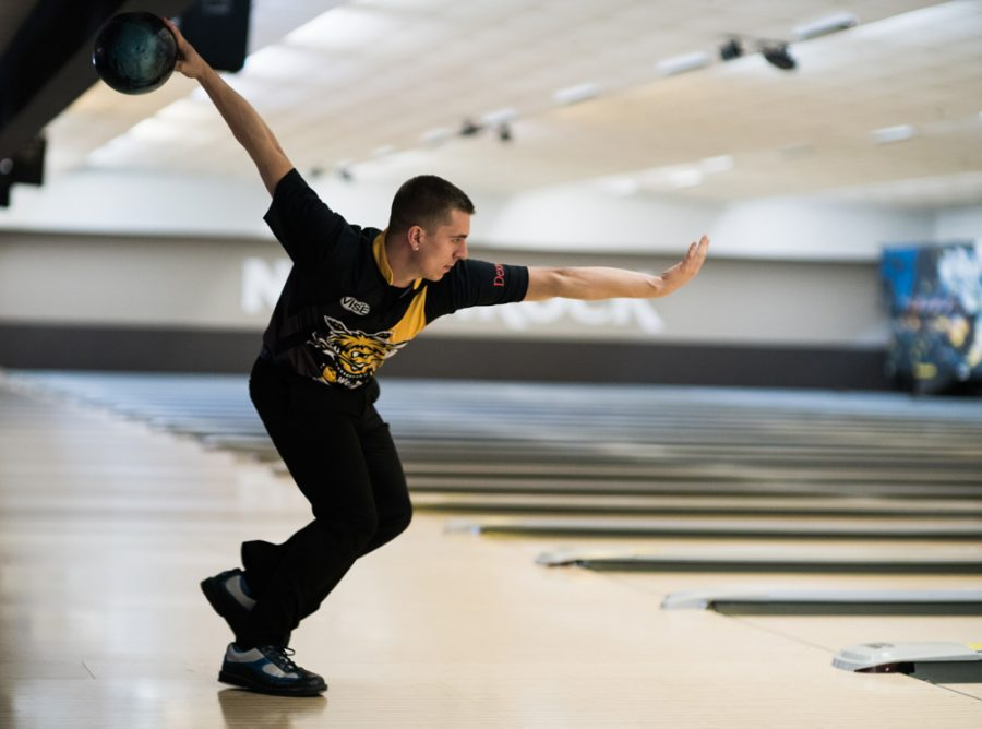 Douglas Wagner slides into a release during a team practice at North Rock Lanes. Wagner was selected to join Wichita State's bowling team this year after transferrring schools.
