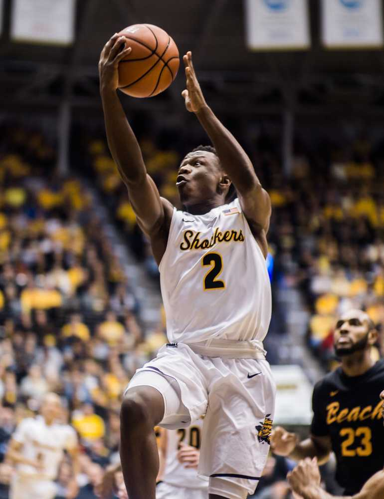 Junior Daishon Smith (2) goes for an easy lay-up in the first half against Long Beach State Sunday night at Charles Koch Arena.