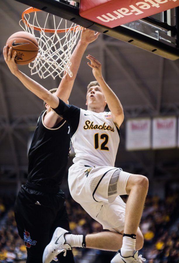 Freshman guard Austin Reeves (12) goes for a contested lay-up in the second half of Wednesday's game against Tulsa at Charles Koch Arena. Wichita State defeated Tulsa 80-53.