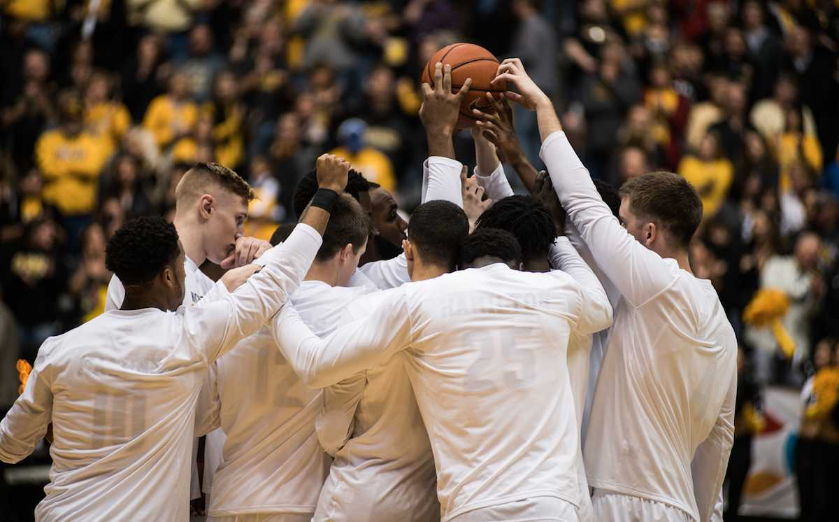 Wichita+State+huddles+before+the+start+of+Friday%27s+game.+