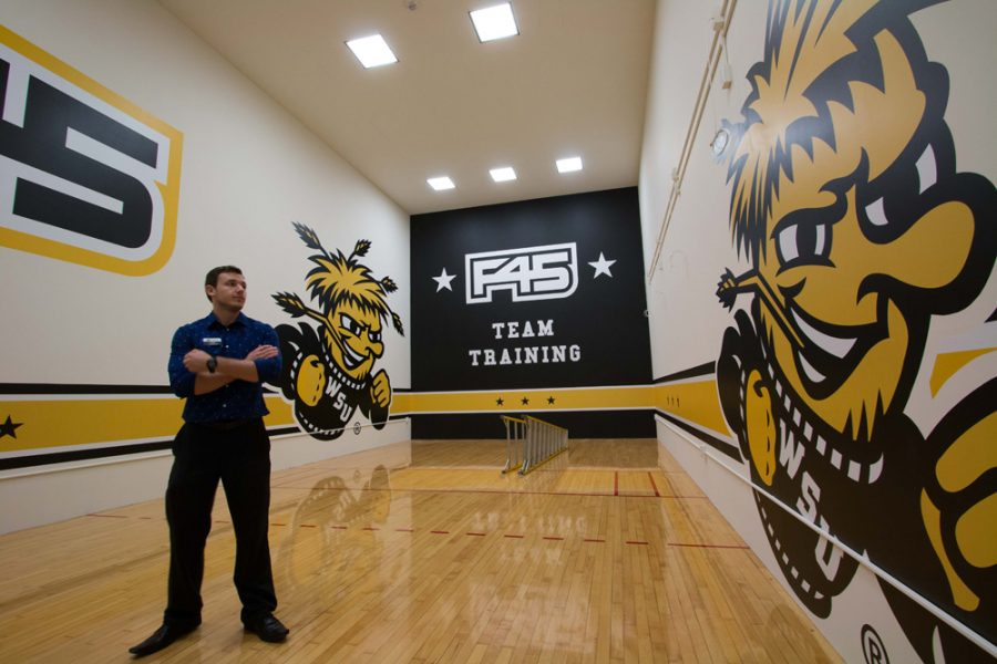 Andy Sykes, coordinator of health and fitness, stands in what will be the space for the new F45 fitness program in the Heskett center. The space will be completed and Sykes will be a certified instructor in the program, in early January. It will be open to students and faculty on Jan. 9.