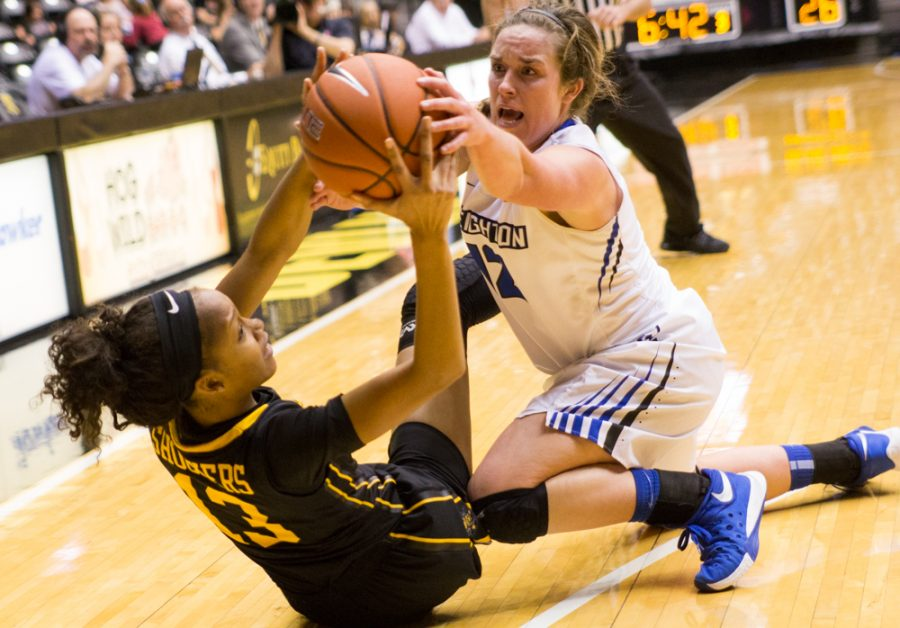 Kayla Williams (13) and Lauren Works (12) fight for the ball in Wichita State's season opener against Creighton at Koch Arena.