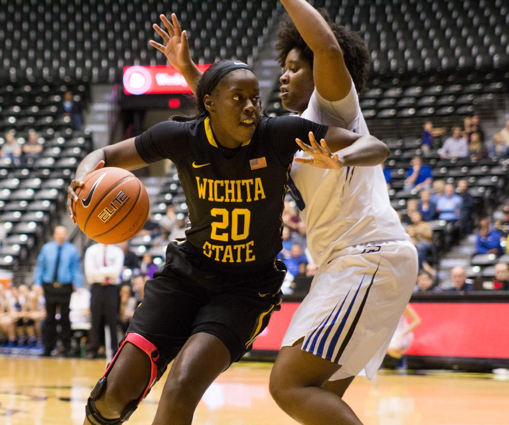 Brittany Martin (20) dribbles around Audrey Faber Sunday afternoon in Koch Arena. Wichita State beat Creighton 62-54.
