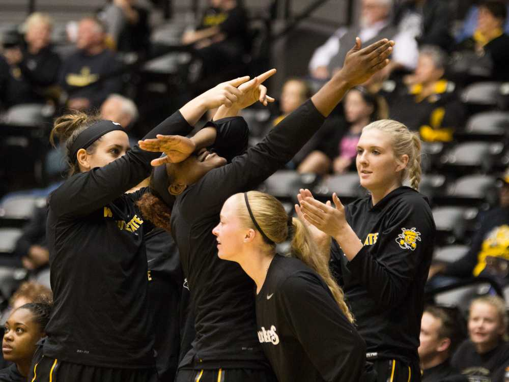 Marija Pacar (left) points and Jyar Francis dabs after Wichita State scores in the fourth quarter.