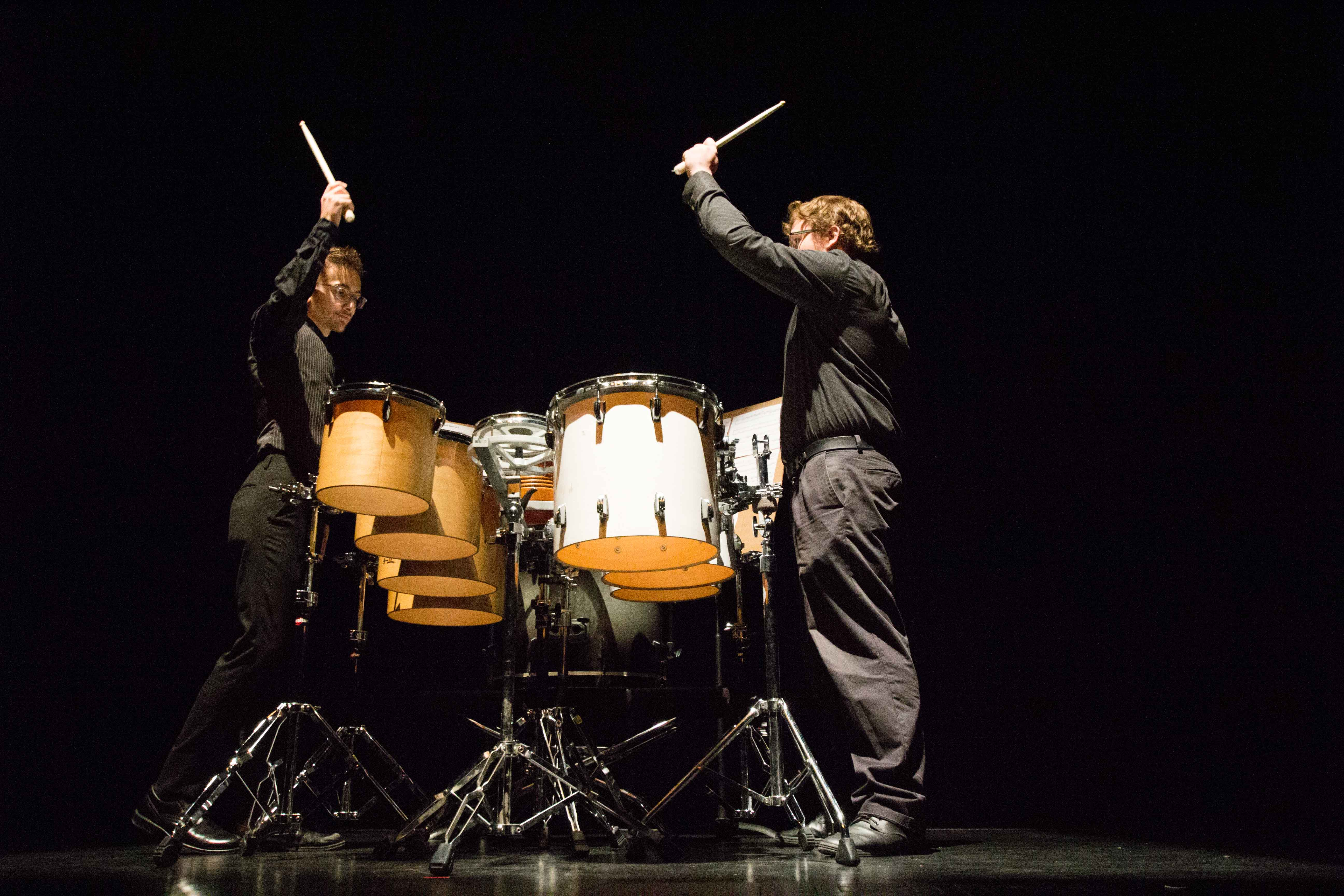 """Juniors Daniel Furry (left) and Spencer Weaver (right) play """"Eight on 3 and Nine on 2"""" composed by G. Clements and R. Marino on a multiple percussion setup on Sunday evening during the Impulse Percussion Group's concert. Furry and Weaver have been rehearsing the piece since the beginning of the summer."""