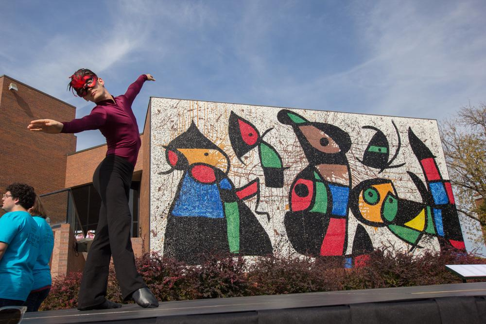 "Dancers preform to a rendition of The Beatles ""Black Bird"" in front of the Ulrich Museum of Art at Wichita State. The dance was part of the unveiling ceremony of the restored Personnages Oiseaux (Bird People) mural."