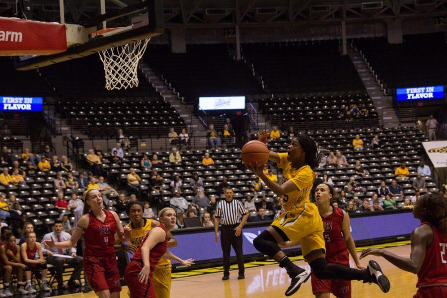 Wichita+State+guard+Jaleesa+Chapel+goes+for+a+layup+against+Newman.