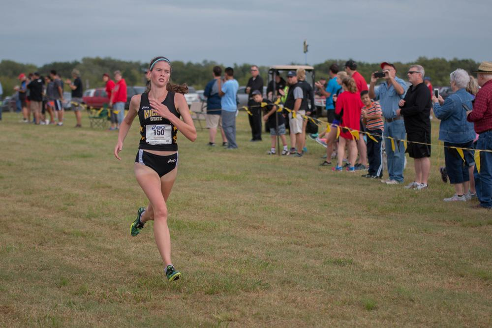 2015 MVC Freshman of the Year winner Rebekah Topham sprints past the crowd at the finish line.