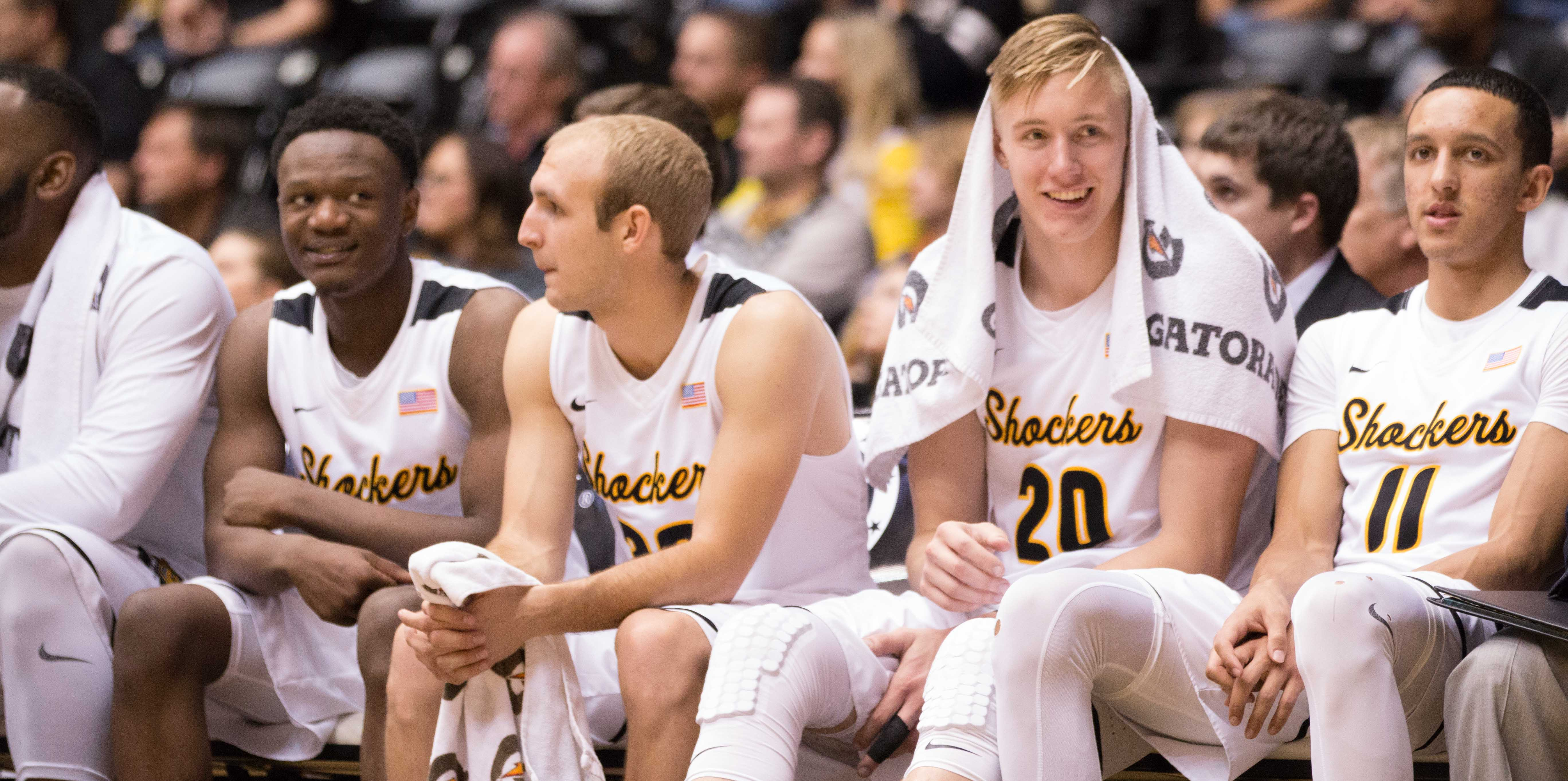 The Wichita State Shocker bench is all smiles as Coach Gregg Marshall cleans out the bench in the closing minutes on the game against Southern Nazarene on Tuesday evening, in Koch Arena.