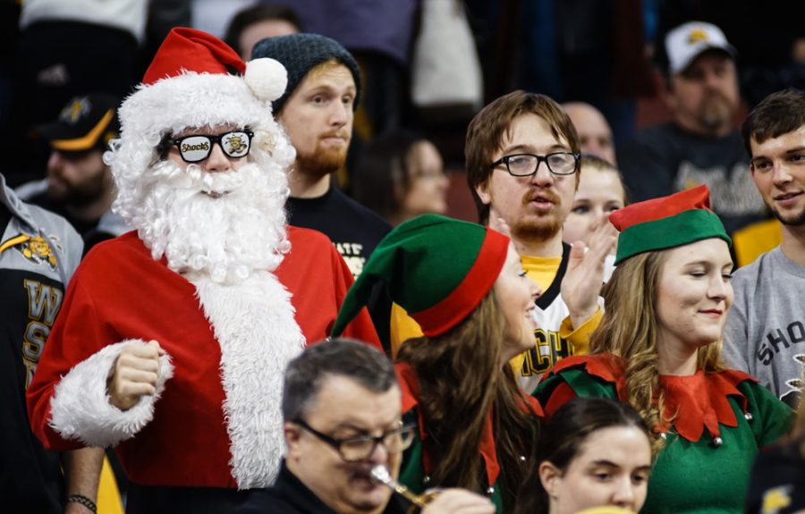 A fan dressed up as Santa Claus gets pumped up prior to the annual INSTRUST Bank Arena game against OSU Saturday evening. The Shockers fell to Oklahoma State by the score of 93-76.
