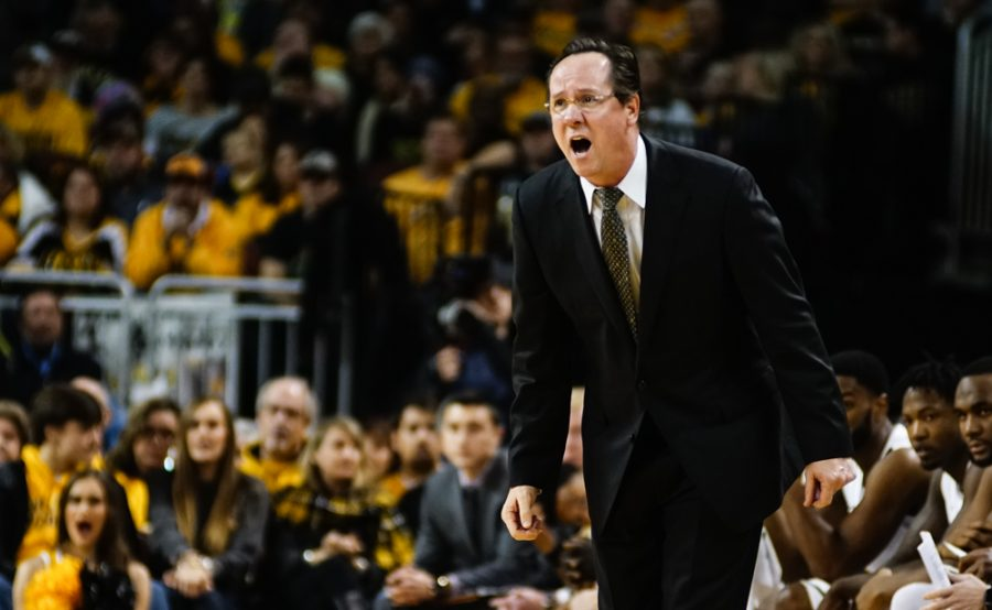 Coach Gregg Marshall screams at his player in frustration in the first half during the annual INSTRUST Bank Arena game Saturday evening. The Shockers fell to Oklahoma State by the score of 93-76.