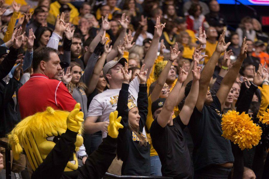 Fans+raise+their+hands+in+the+air+as+a+Wichita+State+player+takes+a+free+throw+shot+Tuesday+night+in+Charles+Koch+Arena.