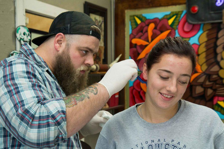 tattoo+artist+Austin+Liebst+shaves+the+area+where+Emma+Hickey+will+be+getting+her+second+tattoo%2C+at+Artist+at+Large.+Hickey%27s+first+tattoo+is+on+her+wrist+and+it%27s+her+mother%27s+handwriting+with+the+message%3A+%22Remember+who+you+are.%22