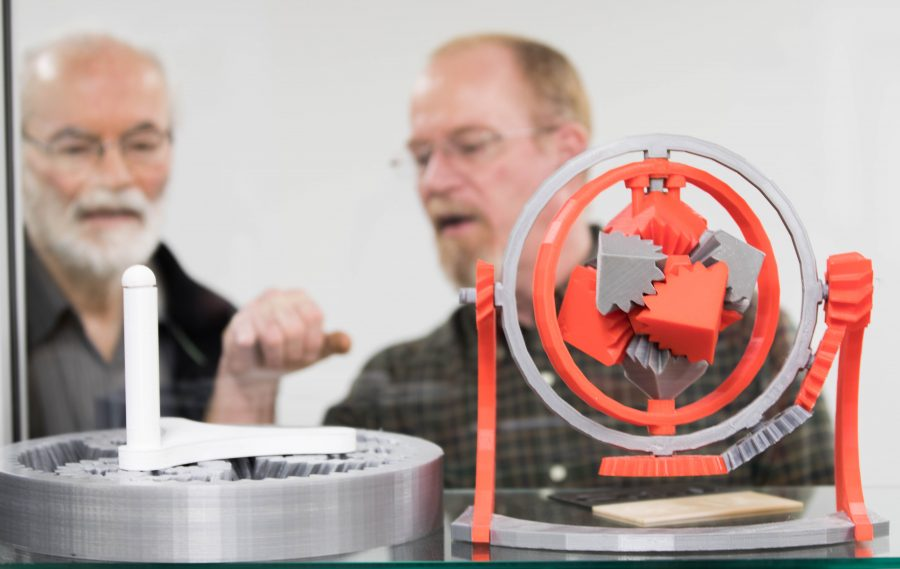 Ken Tedder and Steve Copeland, staff for electrical engineering, looks at an intricate 3-D models made with equipment at the Experiential Engineering Building. The Experiential Engineering Building will offer 3-D printers for students, faculty and the community. (Jan. 17, 2017)