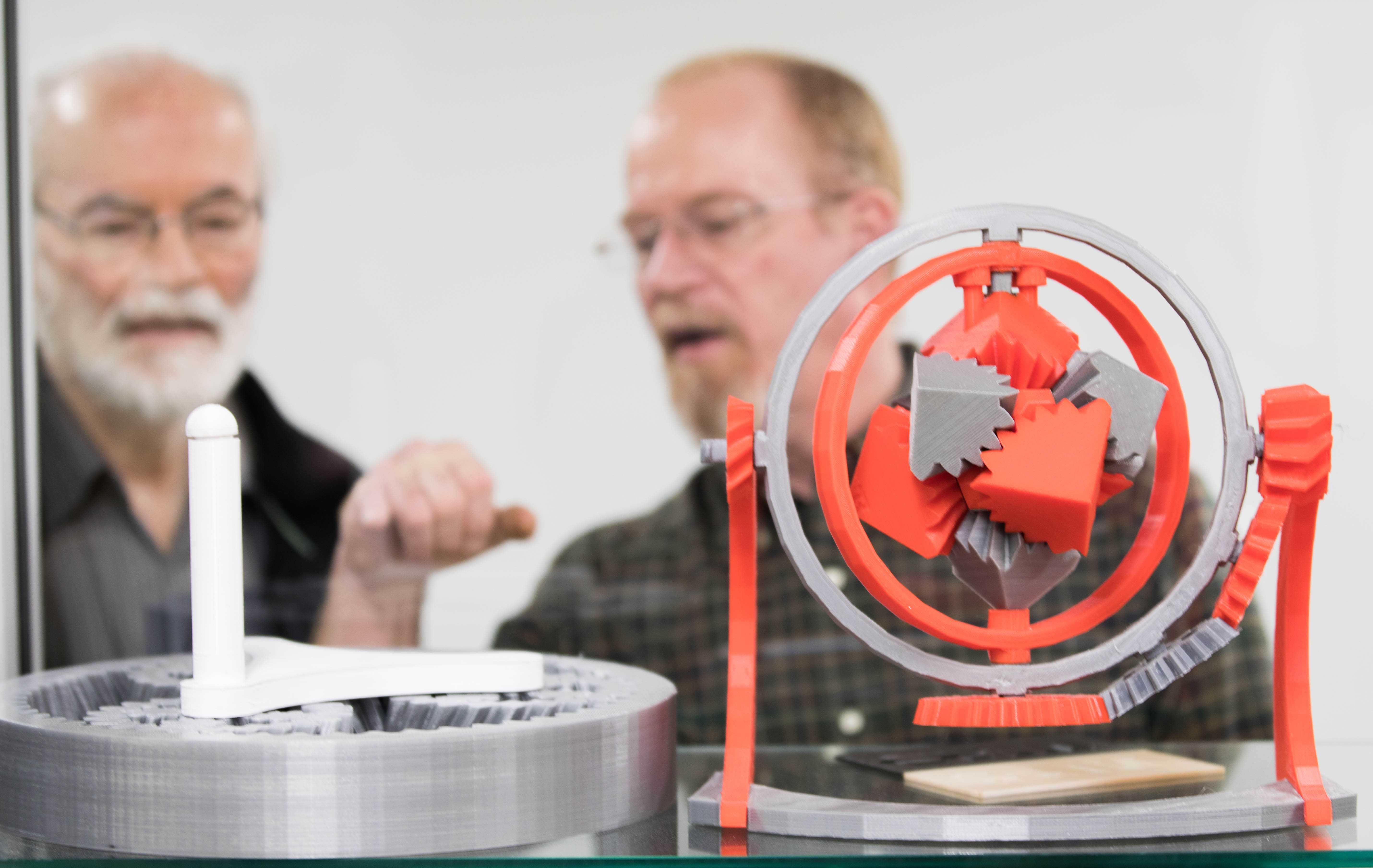 Ken Tedder and Steve Copeland, staff for mechanical engineering, looks at an intricate 3-D models made with equipment at the Experiential Engineering Building. The Experiential Engineering Building will offer 3-D printers for students, faculty and the community. (Jan. 17, 2017)