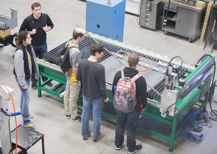 A group of students tours the metal fabrication in the Experiential Engineering Building. The building has several 25 different laboratories. (Jan. 17, 2017)