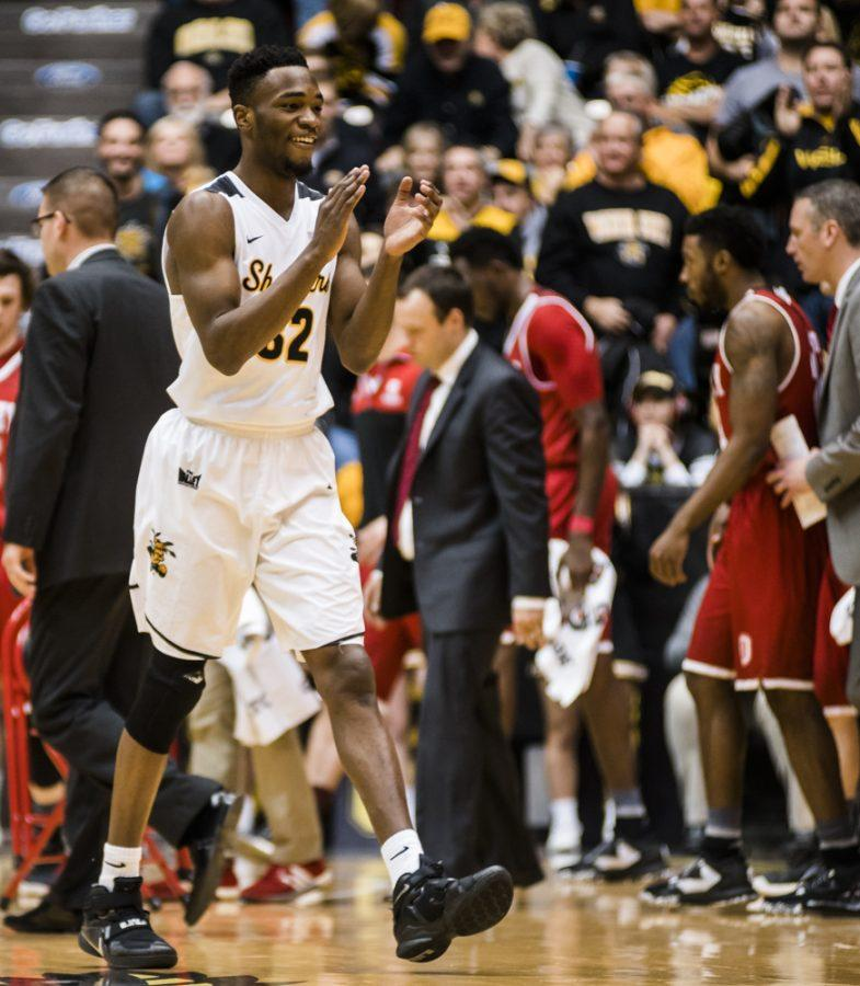 Sophomore forward Markis McDuffie (32) celebrates a score in the second half during Sundays afternoon game against the Bradley Braves at Charles Koch Arena.