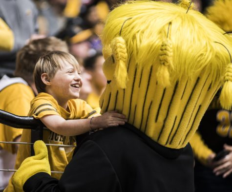 A fan hugs Wu during Wednesdays game against Drake at Charles Koch Arena. (Jan. 4, 2017)