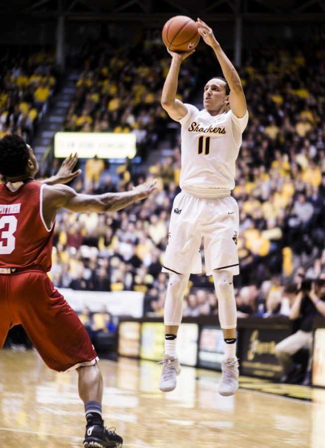 Freshman+guard+Landry+Shamet+%2811%29+attempts+a+jumper+over+a+Bradley+defender+in+the+first+half+Sunday+afternoon+at+Charles+Koch+Arena.+The+Shockers+went+on+to+pummel+the+Braves+100-66.