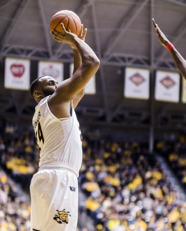 Junior center Shaq Morris (24) attempts a jumper in the second half during Sunday afternoon's game against Bradley at Charles Koch Arena. The Shockers went on to pummel the Braves 100-66.