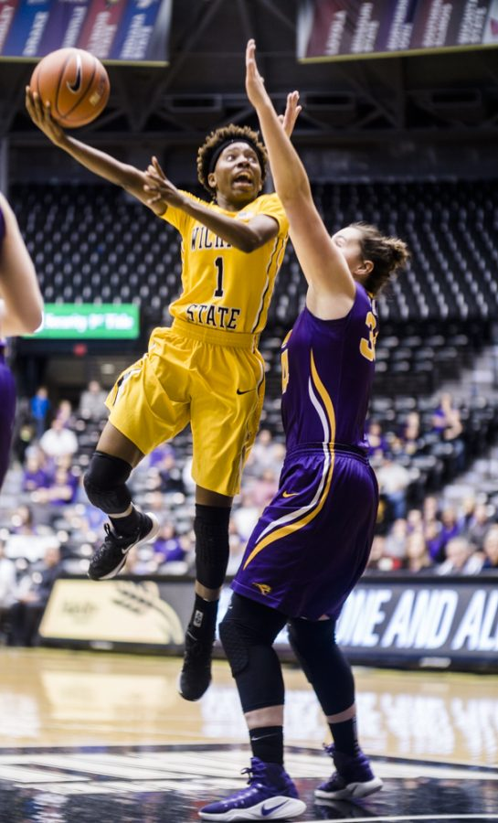 Junior guard Keke Thompson (1) goes up for a contested jumper over a UNI defender in the fourth quarter Sunday afternoon at Charles Koch Arena. (Dec 1st, 2016)