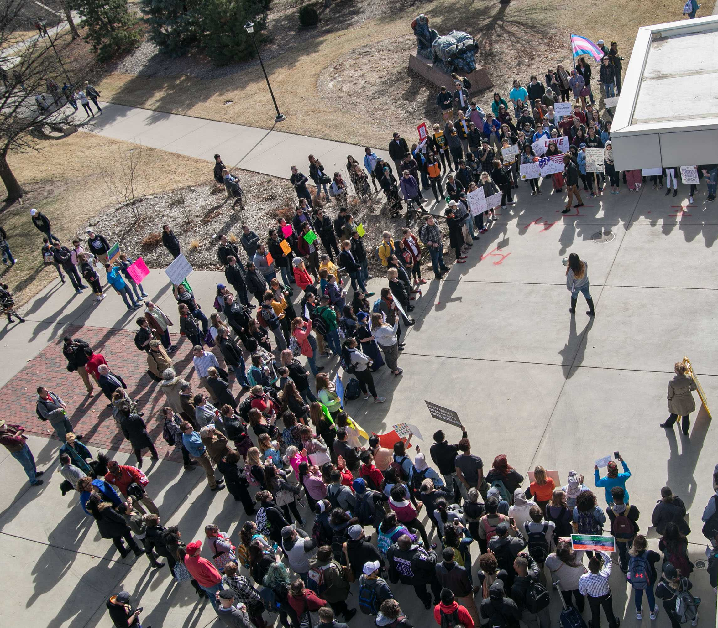 A crowd gathers outside the Rhatigan Student Center for the