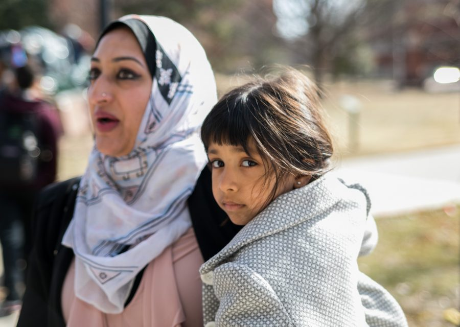 """Sana Malik holds her daughter Inaya, 3, at the """"No Ban, No Wall"""" peace rally held on Tuesday afternoon at Wichita State. Malik is an adjunct faculty member and advisor to the Muslim Student Association. """"At this time there is so much hateful rhetoric on many different levels. It's a really important time to try and unify people based on the common humanity that we share. I believe the country was founded on the principles of justice and equality, and that is what we will continue to stand up and fight for."""" (Jan. 31, 2017)"""
