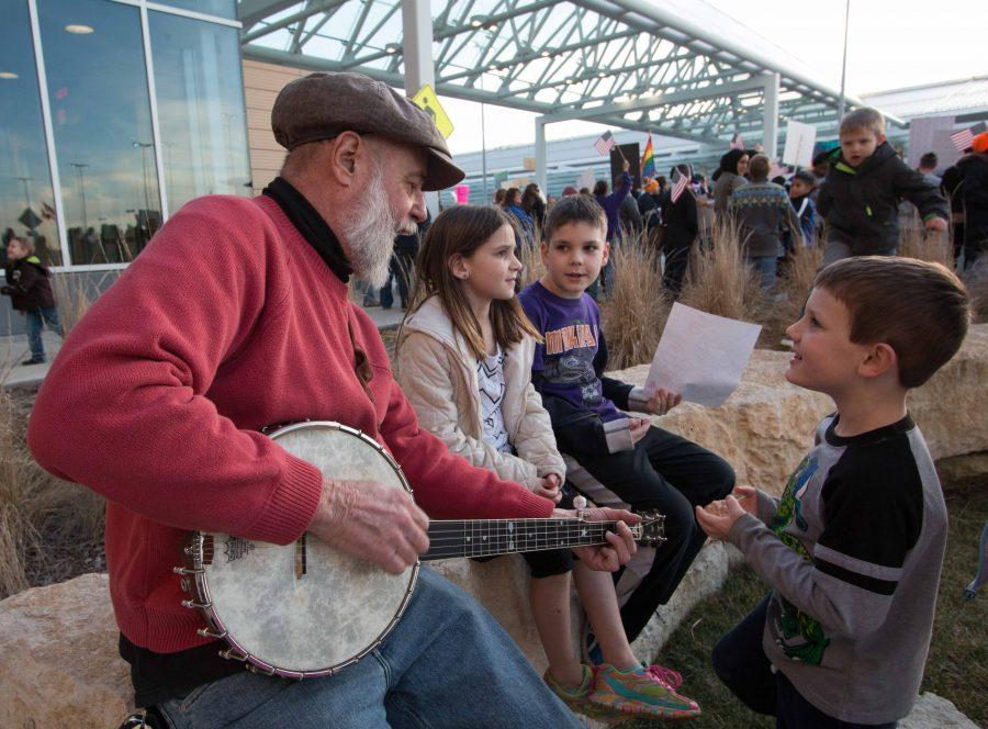 Tom+James+plays+the+banjo+and+sings+to+a+group+of+children+during+the+refugee+solidarity+gathering+held+Sunday+afternoon+at+the+airport.+%28Jan.+29%2C+2017%29