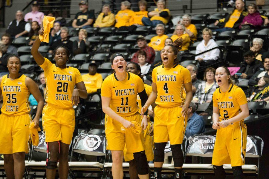 Shockers cheer on their teammates during first half of the game at Koch Arena. WSU has won its fourth straight game on Friday against Indiana State.