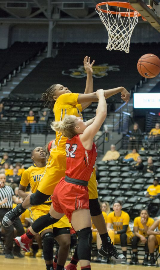 Wichita+State+forward+Angiee+Tompkins+moves+to+block+Redbird+guard+Brechelle+Beachum+at+Koch+Arena+Sunday+afternoon.