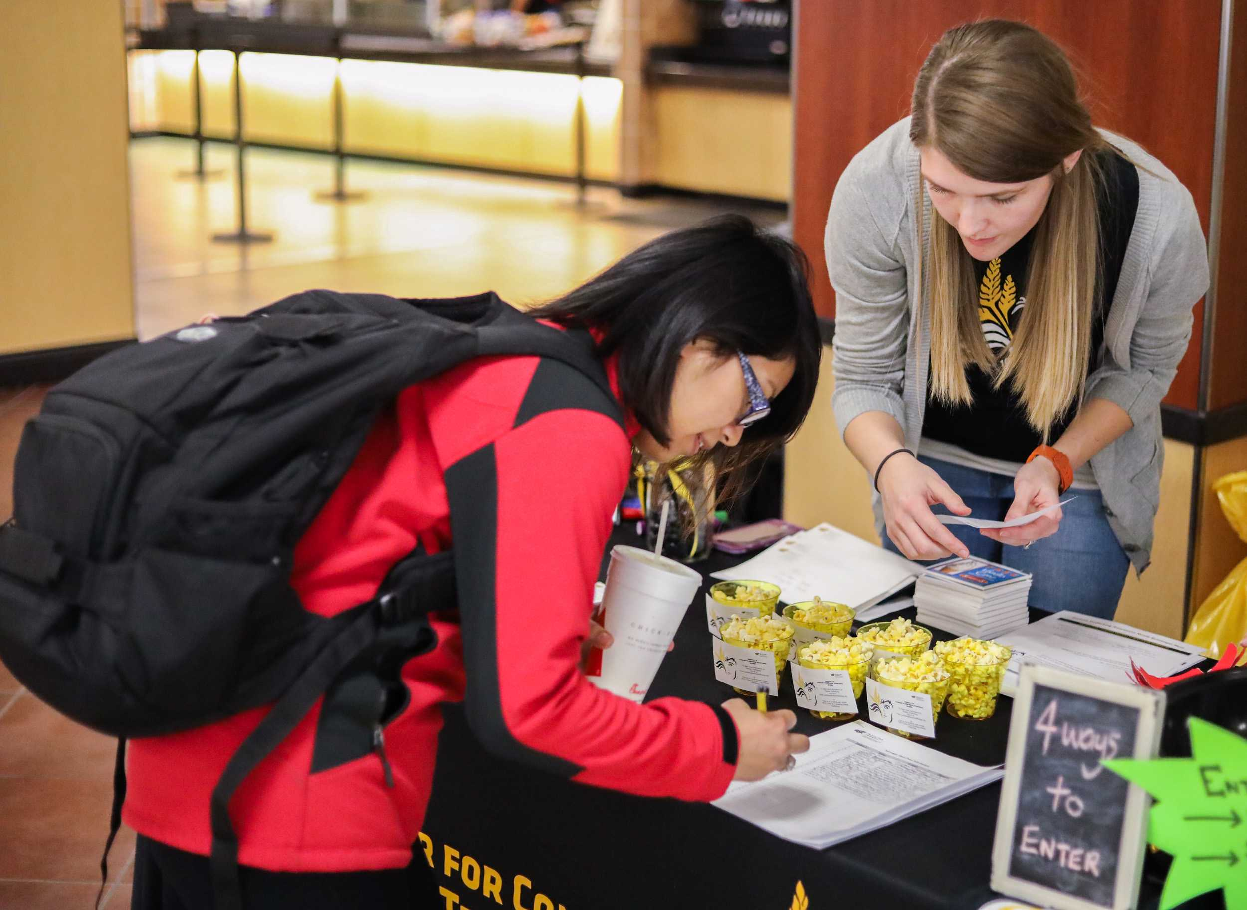 Kalynn Cheyney (right) with the Center for Combating Human Trafficking speaks with a Wichita State student (left) during their awareness event in the Rhatigan Student Center. (Jan. 25, 2017)
