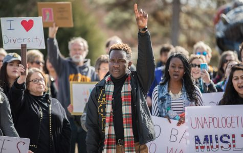 "Student body president Joseph Shepard holds up his hand while exciting the crowd at the ""No Ban, No Wall"" peace rally. The Rally took place outside of the Rhatigan Student Center on Tuesday afternoon and was to show solidarity to those who feel marginalized by President Trump's rhetoric. (Jan. 31, 2017)"