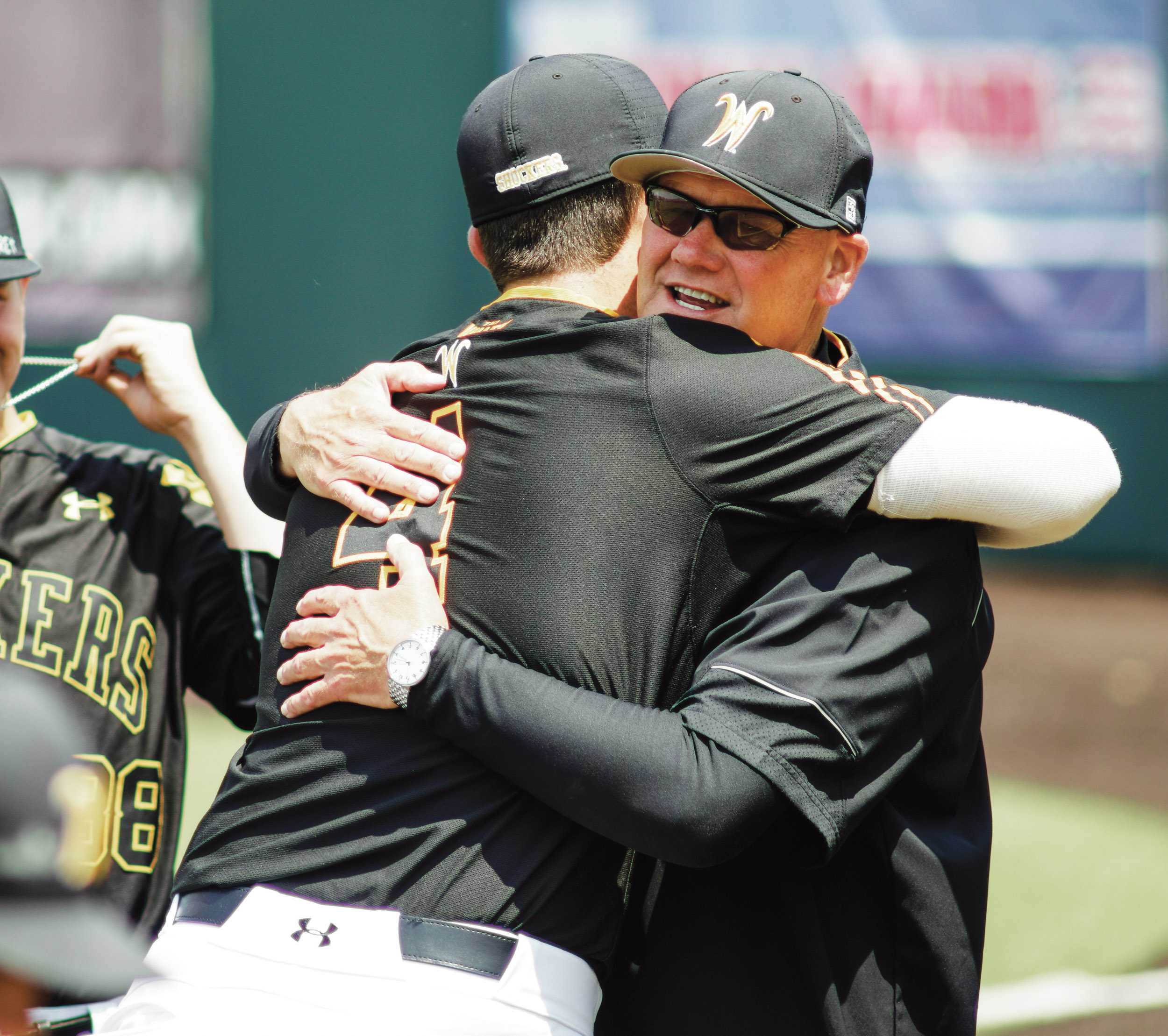Assistant Coach Brent Kemnitz hugs pitcher Cale Elam in the bullpen Saturday afternoon at Eck Stadium.(May 21st, 2016)
