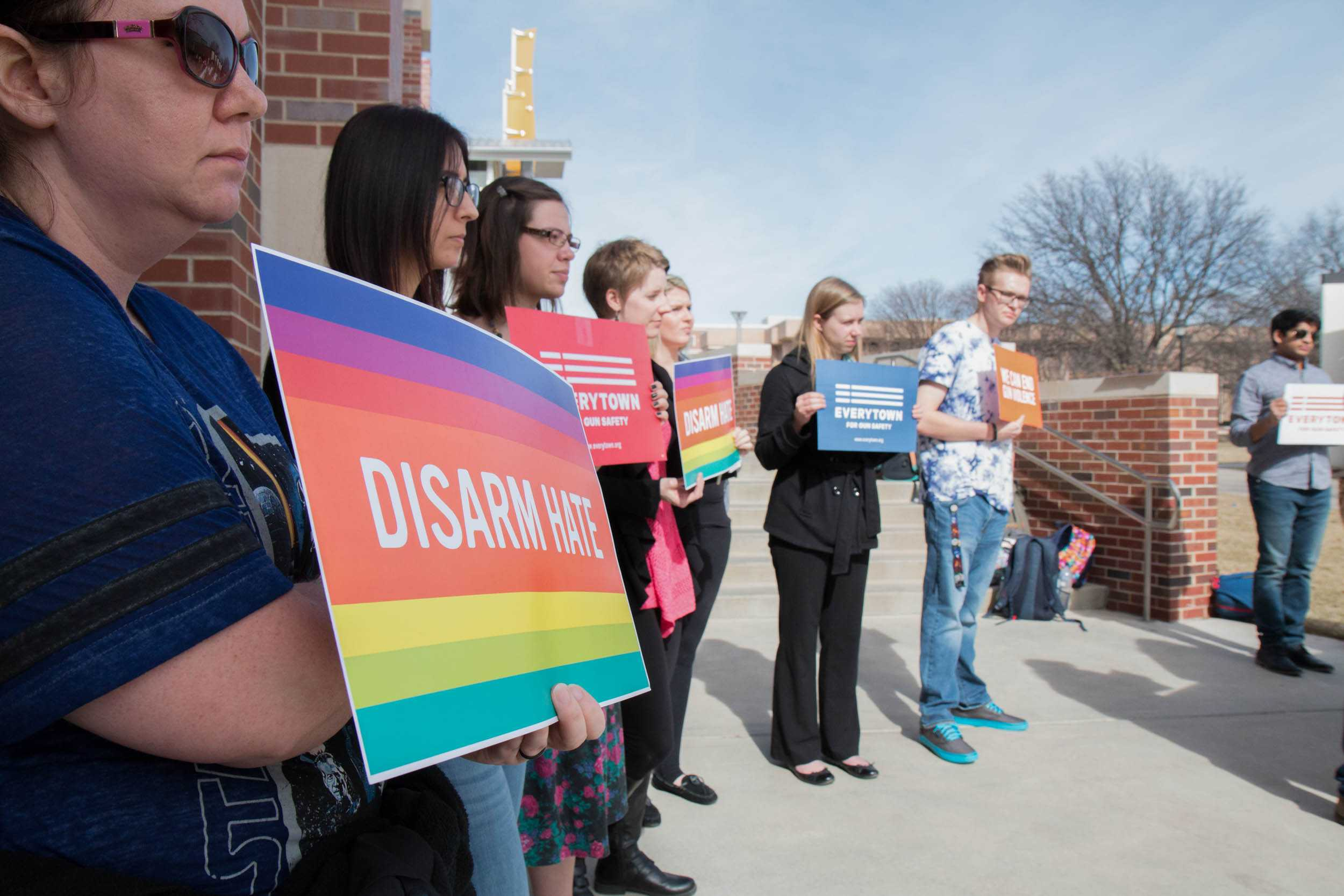 Protesters stand outside the RSC Tuesday afternoon. The Community Psychology Association hosted the event to show their opposition in allowing firearms on campus.