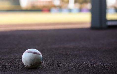 A lone baseball sets on the edge of the dugout at Eck Stadium.