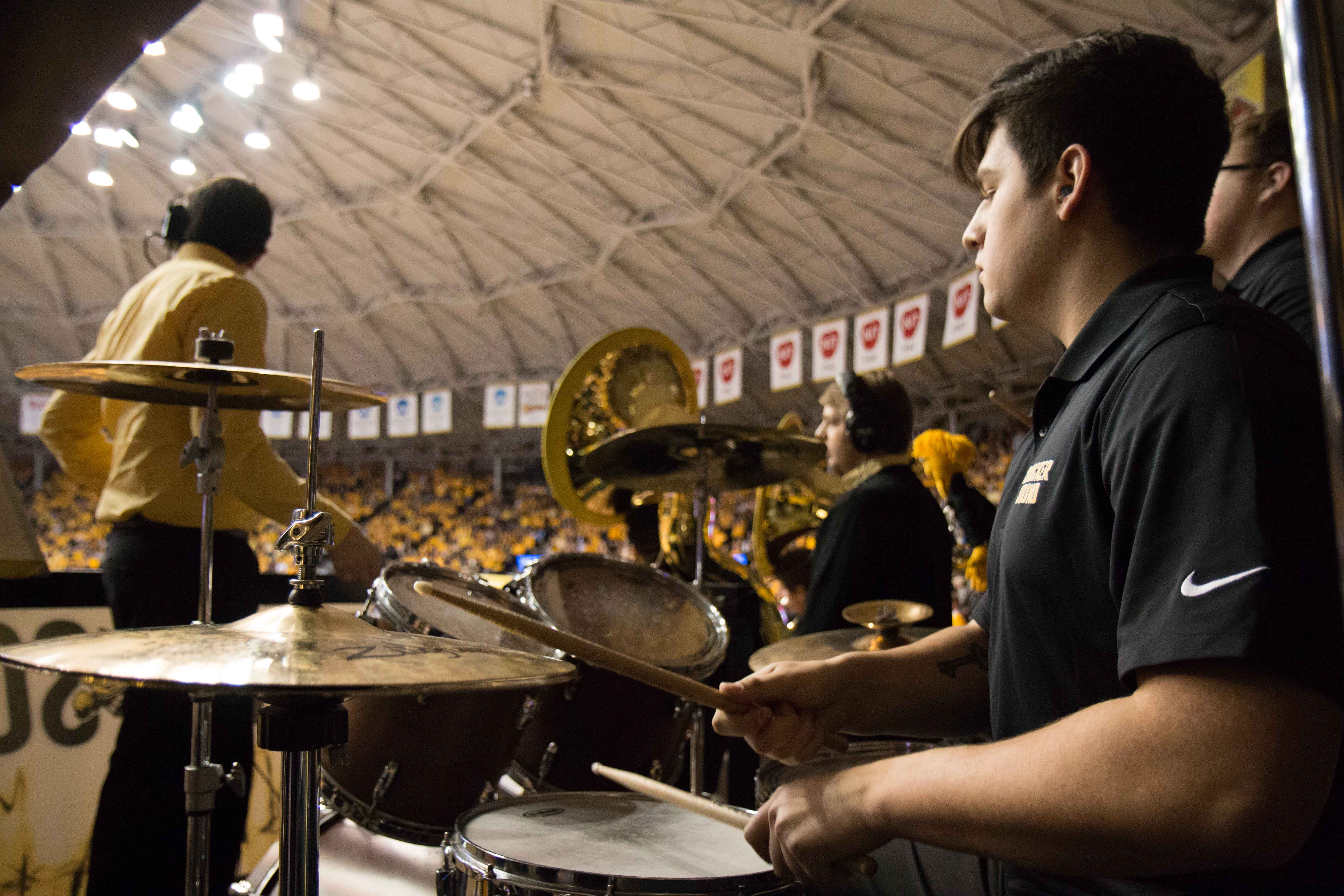 Wyatt Vieux, a member of the Shocker Sound, plays the drums during the game against Illinois State Saturday night. (Feb. 4, 2017)